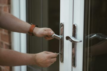 a person opening the doors with a key